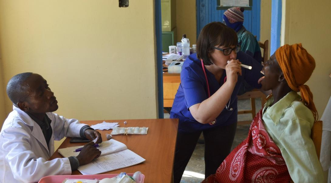 Projects Abroad Irish intern is pictured examining a local womans mouth in a hospital as part of her nursing internship in Kenya.